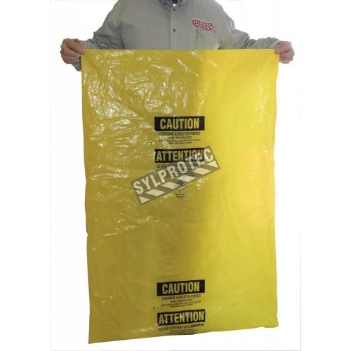 """Sacs jaunes bilingues pour déchets d'amiante. Pour le transport de déchets dangereux. 33""""x50"""", 100 sacs/rouleau."""