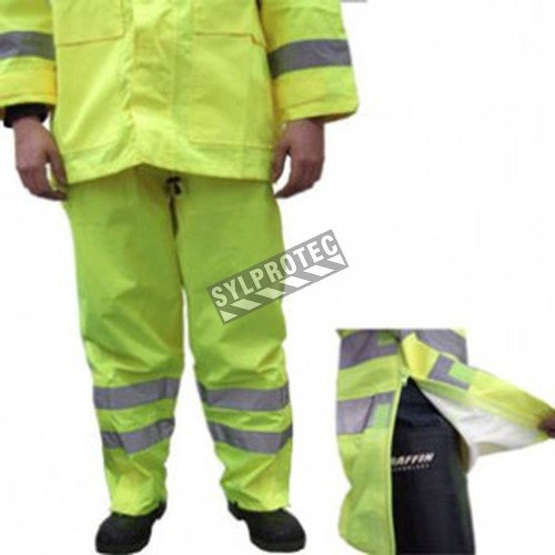 High visibility fluorescent yellow rain pants with silver reflective stripes.
