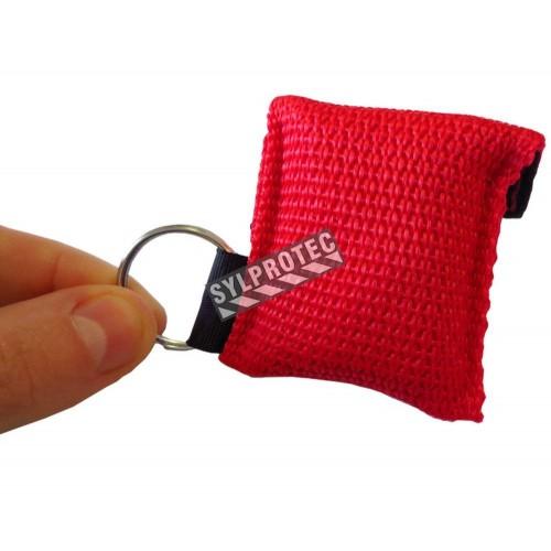 Écran facial pour réanimation (RCR) avec valve dans une poche porte-clés.