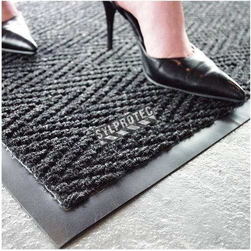 Chevron entrance carpet, 5/16 in made of charcoal gray polypropylene.
