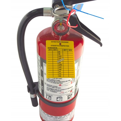 Yellow plastic monthly inspection tag for fire extinguishers, labelling in French, covering 4 years.