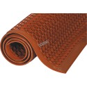 Red carpet 7/8 in, made of vulcanized rubber with cylindrical flow openings and rising grooves.