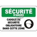 Affiche OSHA «Sécurité d'abord Casque de sécurité obligatoire dans cette zone»: langues, options, formats & matériaux variés